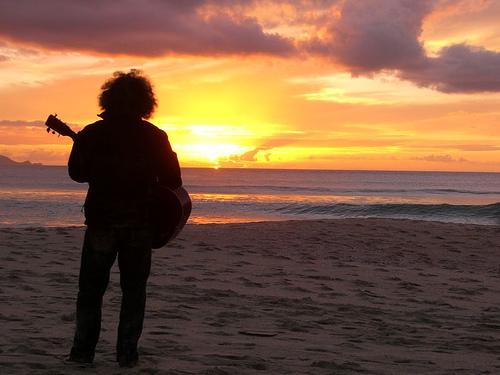 guitarist on beach